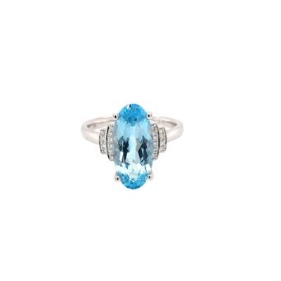 9ct White Gold Elongated Oval Cut Blue Topaz And Brilliant Cut Diamond Dress Ring.