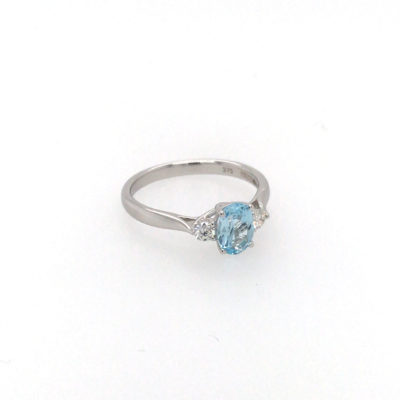 9ct White Gold Oval Blue Topaz And Brilliant Cut Diamond Dress Ring.